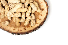 Pile of unshelled peanuts, isolated on white Stock Photography