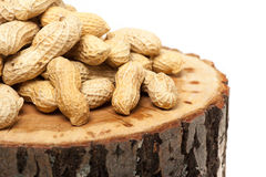 Pile of unshelled peanuts,  on white Royalty Free Stock Photos