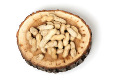 Pile of unshelled peanuts,  on white Stock Photo