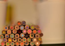 Pile-up: Colour Pencils cross-section background. Colour pencils piled up on a glass surface to show the cross-section - making the abstract / blurred background stock images