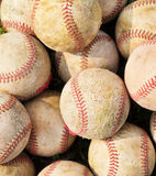 Pile up a stack of old baseball in green Stock Photo