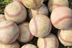 Pile up a stack of old baseball in green Stock Images