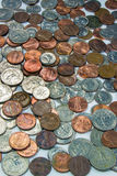 Pile of US Coins. Vertical image of a pile of US coins stock photo