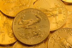 Pile of US Treasury Gold Eagle one ounce coins. Pile of golden coins with Gold Eagle on US Treasury issue one ounce pure gold coin royalty free stock photography