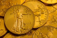 Pile of US Treasury Gold Eagle one ounce coins. Pile of golden coins with Liberty on US Treasury issue Gold Eagle one ounce pure gold coin stock photo