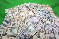 Pile of USA currency green background Royalty Free Stock Image