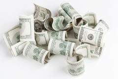 Pile of USD United States dollars on white table. Pile of United States dollar hundred USD banknotes on white table. Selective focus Stock Photos
