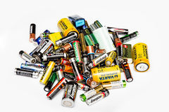 Pile of used batteries. Various sizes collected for recycling isolated on white background royalty free stock photos