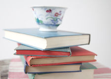 Pile of used books with teacup Royalty Free Stock Images