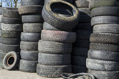 A pile of used car tires stacked in a rubber tower Royalty Free Stock Image