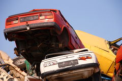 Pile of used cars. In junkyard, ready for salvage Stock Image