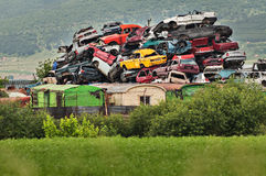 Pile of used cars in junkyard. Ready for salvage Royalty Free Stock Image