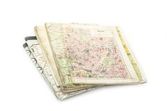 Pile of used maps with Vienna one on the top on the white. Pile of used maps with Vienna one on the top on the white royalty free stock photos