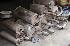 Pile of Used Muffler Stock Photo