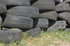 Pile of used old rubber tire Five Royalty Free Stock Image