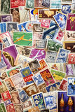 Pile of used post stamps from Romania Stock Photography