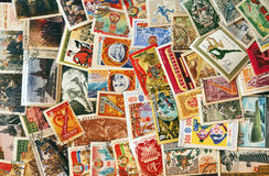 Pile of used post stamps from Soviet Union. Lenin, astronauts, revolution, sociaslism, etc Royalty Free Stock Photo