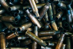 Pile of used rifle cartridges 7.62 mm caliber, many empty bullet shells, assault rifle bullet shell, military background, top view royalty free stock images