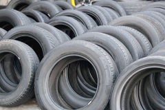 Pile of used rubber tyres. Royalty Free Stock Photos