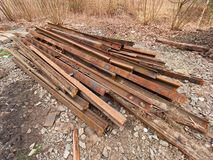 Pile of used rusty rails. Stock of steel rails at old closed railway station.  Metal material Stock Images