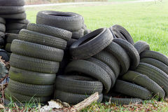 Pile of used tires in  countryside Royalty Free Stock Photography