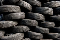 Pile of used tires on scrap yard royalty free stock photos