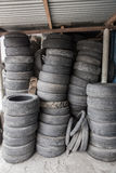 Pile of used tires and wheels. A portrait of Pile of used tires junk Stock Image