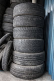 Pile of used tires and wheels. A portrait of Pile of used tires junk Royalty Free Stock Image