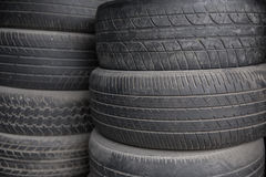 Pile of used tires and wheels. A portrait of Pile of used tires junk Stock Photos