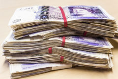 Pile of used UK 20 pound notes Royalty Free Stock Photography