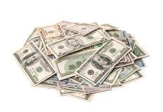 Pile of varied dollar bills. On white Stock Photos