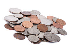 Isolated US Coins Pile. A pile of various American coins (quarters, dimes, nickels, pennies) isolated on white background Royalty Free Stock Image