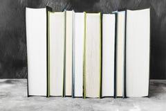 Pile of various books on dark background.  Stock Photos