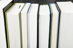 Pile of various books on dark background.  Stock Photo