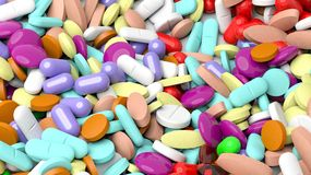 Pile of various colorful pills. Background Royalty Free Stock Images