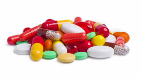 Pile of various colorful pills isolated on white Royalty Free Stock Photography