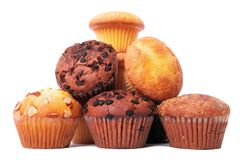 Pile of various different muffin cup cakes. White background Stock Photography