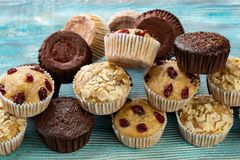 Pile of various different muffin cupcakes stock photo