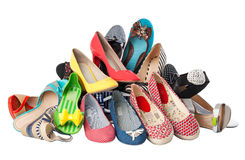 Pile of various female summer shoes, with path stock image