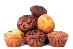 Pile of various muffin cup cakes isolated white background. Pile of various muffin cup cakes Royalty Free Stock Photography