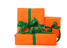 Pile of various orange wrapped presents stock image
