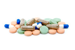 Pile of various pills and tablets. Isolated on the white background Stock Image