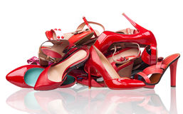 Pile of various red female shoes over white Stock Photography