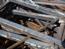 Pile of various sized scrap iron profiles in a scrap metal pile Royalty Free Stock Images