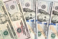 Pile of various US dollar (USD) money bills spread and sorted by stock photos