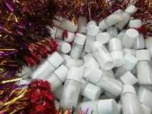 A pile of vials of white powder. Bottles with white salt royalty free stock image