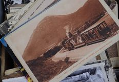 Pile of vintage black and white, sepia postcards for sale. royalty free stock photos