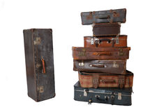 Pile of vintage luggage. Pile of old vintage suitcases - luggage isolated on white Royalty Free Stock Photography