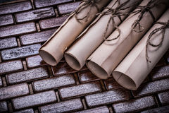 Pile of vintage parchment rolls on wicker wooden Stock Images