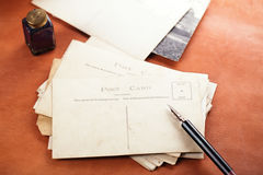 Pile of vintage post cards with  ink pen inkpot Royalty Free Stock Photography
